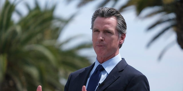 California Gov. Gavin Newsom talks during a news conference at Universal Studios in Universal City, Calif. On Wednesday, he signed a bill into law intended to combat organized retail theft.