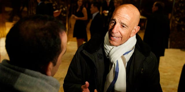 This photo from Tuesday Jan. 10, 2017, shows Tom Barrack speaking with reporters in the lobby of Trump Tower in New York before meeting with President-elect Donald Trump.