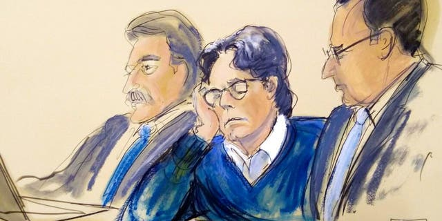 FILE - In this June 18, 2019, file courtroom artist's sketch, defendant Keith Raniere, center, sits with attorneys Paul DerOhannesian, left, and Marc Agnifilo during closing arguments at Brooklyn federal court in New York.