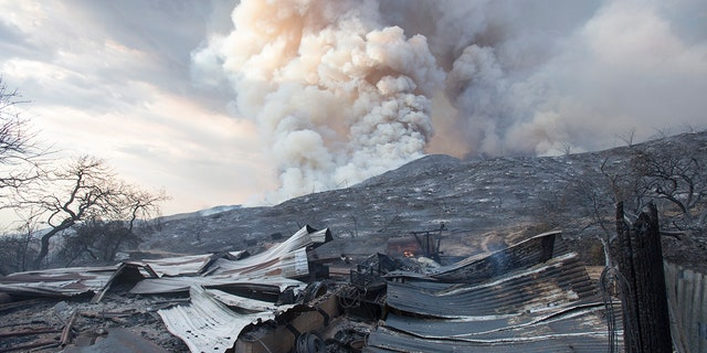 A burned structure is seen at a wildfire in Yucaipa, Calif on Sept. 5, 2020. (AP Photo/Ringo H.W. Chiu, File)