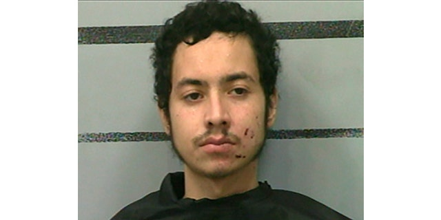 Omar Soto-Chavira is charged in the fatal shooting of a SWAT officer in Texas, prosecutors say. (Lubbock County Detention Center via Associated Press)