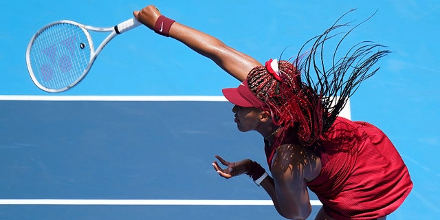Naomi Osaka, of Japan, serves to China's Zheng Saisai during the tennis competition at the 2020 Summer Olympics, Sunday, July 25, 2021, in Tokyo, Japan. (Associated Press)