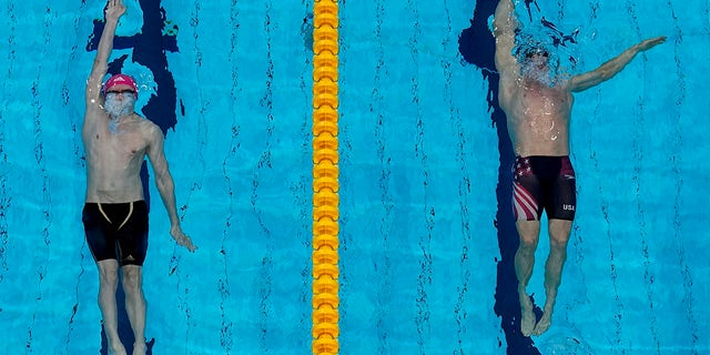 Ryan Murphy, of the United States, and Kliment Kolesnikov, of the Russian Olympic Committee, swim in the final of the men's 100-meter backstroke final at the 2020 Summer Olympics, Tuesday, July 27, 2021, in Tokyo, Japan. (AP Photo/Morry Gash)