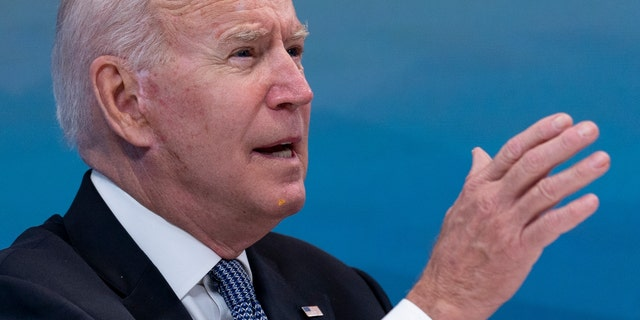President Biden  has something small and yellow on his chin as he speaks during a meeting with governors. (AP Photo/Andrew Harnik)