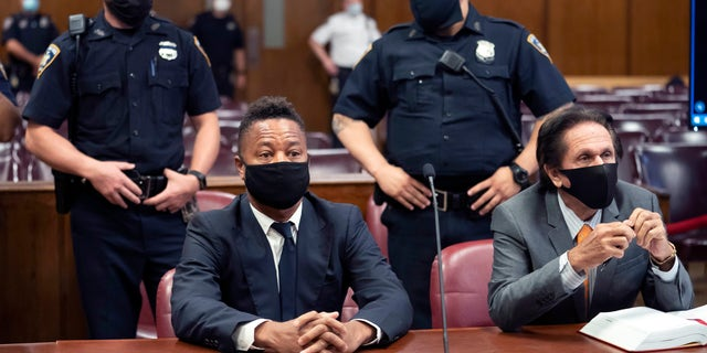 FILE - In this Aug. 13, 2020 file photo, Cuba Gooding Jr., front left, sits at the defense table with his lawyer Marc Heller, during a hearing in his sexual misconduct case in New York. (Steven Hirsch/New York Post via AP, Pool, File)