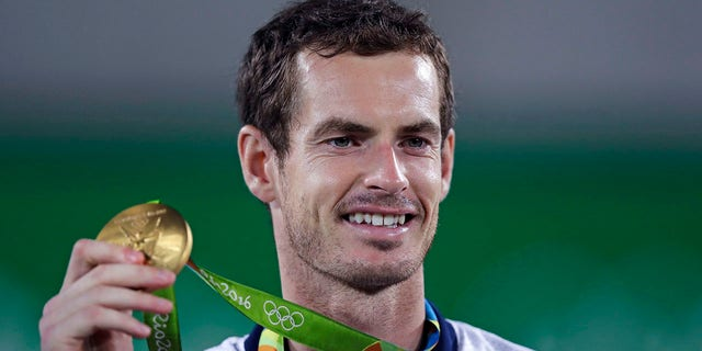 FILE - Andy Murray, of England, smiles as he holds up his gold medal at the 2016 Summer Olympics in Rio de Janeiro, Brazil, in this Sunday, Aug. 14, 2016, file photo. (AP Photo/Charles Krupa, File)
