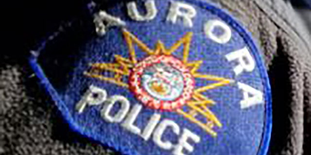 The Aurora Police Department said it issued the warrants for officers John Haubert and Francine Martinez