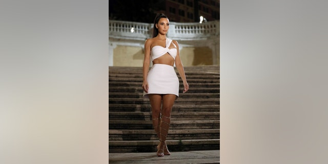 Kim Kardashian and BFF and KKW Brands executive Tracy Romulus, make-up artist Mario Dedivanovic and hairstylist Chris Appleton were seen stopping by the famous Spanish Steps to take photos during a late Wednesday night stroll.