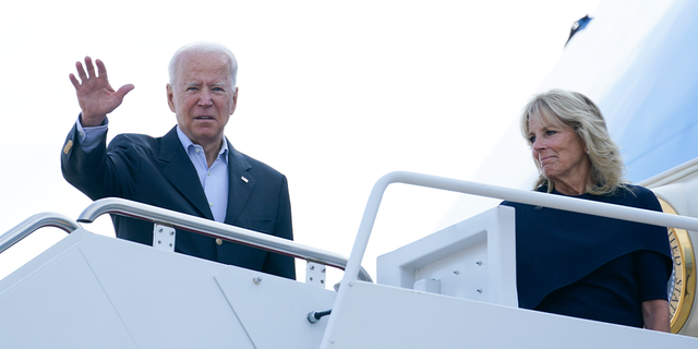 President Joe Biden and first lady Jill Biden board Air Force One at Andrews Air Force Base, Md., on Thursday. (AP)
