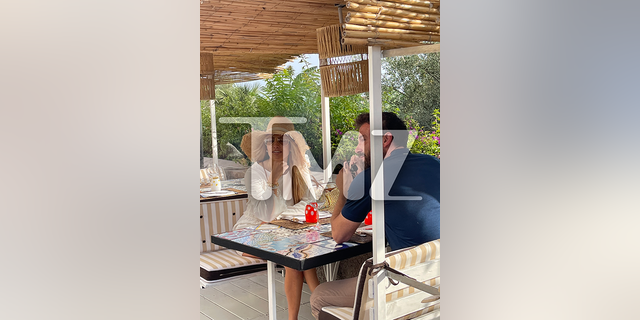 Jennifer Lopez and Ben Affleck at a restaurant in Italy.