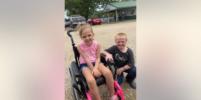 Jesse Starr, 8 (right) helped his friend Claire Calvin (left) who was diagnosed with a brain tumor in 2020, raise money for medical expenses by selling his pet hog.