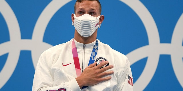 Caeleb Dressel of the United States stands on the podium after receiving his gold medal for the men's 100-meter freestyle at the 2020 Summer Olympics, Thursday, July 29, 2021, in Tokyo. (Associated Press)