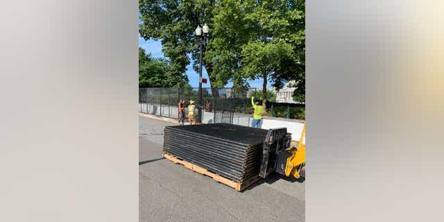 Crews began dismantling the inner Capitol fence Saturday morning.  (Kelly Laco / Fox News)