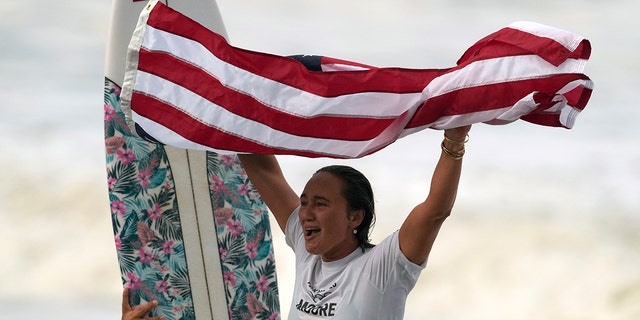 Carissa Moore, of the United States, celebrates winning the gold medal of the women's surfing competition at the 2020 Summer Olympics, Tuesday, July 27, 2021, at Tsurigasaki beach in Ichinomiya, Japan. (Associated Press)