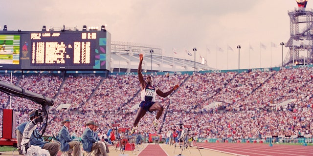 Carl Lewis of the United States competing in the men's long jump on July 29, 1996, at the XXVI Summer Olympic Games at the Alexander Memorial Coliseum in Atlanta, Ga. (Mike Powell/Allsport/Getty Images)