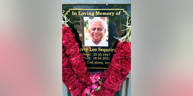 In this photo provided by the Rev. Cedric Prakash, a plaque memorializes the Rev. Jerry Sequeira, who died from the coronavirus on April 18, 2021, in Ahmedabad, India.