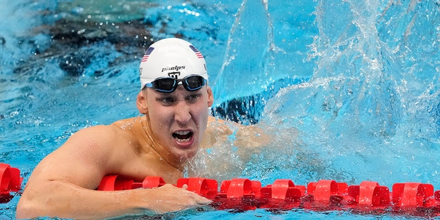 Chase Kalisz of the US reacts after winning the Men's 400m individual medley at the 2020 Summer Olympics, Sunday, July 25, 2021, in Tokyo. (Associated Press)