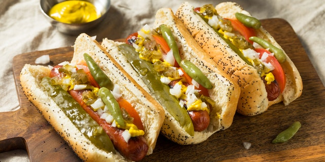 Americans' second favorite regional style of hot dog is Chicago style. Chicago hot dogs are all-beef franks topped with yellow mustard, dark green relish, chopped raw onion, a pickle spear, sport peppers, tomato slices and celery salt, served in a poppy seed bun.