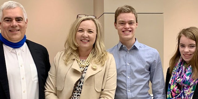 """Ryland DIckman is pictured with his parents and his twin sister. His mom, Latricia, told Fox News that her son is """"very determined and goal-driven."""""""