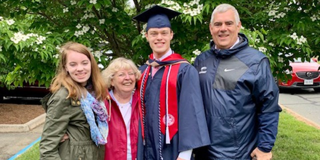 Dickman is pictured with his family. Now that he's graduated from both high school and college, he plans to attend law school in Europe. He hopes to be an international business lawyer.