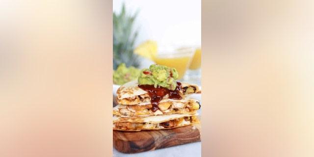 "Tieghan Gerard, the creator of Half-Baked Harvest shared her ""Hawaiian BBQ Quesadillas with Pineapple-Mango Guacamole"" recipe with Fox News for National Avocado Day."
