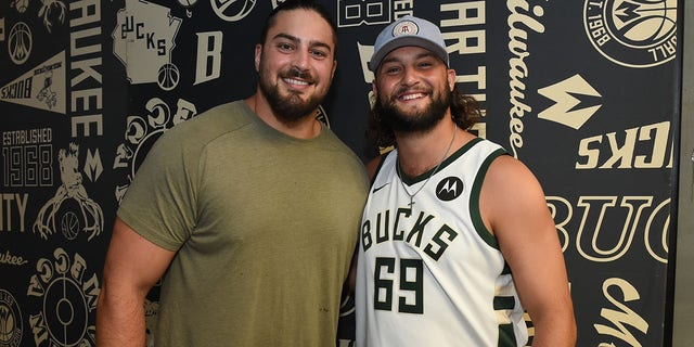 Green Bay Packers David Bakhtiari and Dana Beers at Game Three of the 2021 NBA Finals between the Phoenix Suns and Milwaukee Bucks on July 11, 2021, at Fiserv Forum Center in Milwaukee, Wis. (David Dow/NBAE via Getty Images)