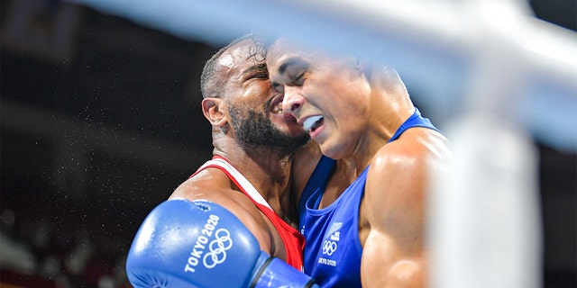 Morocco's Youness Baalla was disqualified from the Olympics on Tuesday after he attempted to bite the ear of New Zealand boxer David Nyika, organizers said.