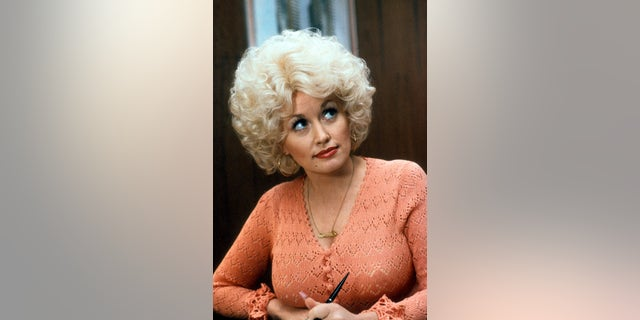 Dolly Parton in a scene from the film 'Nine To Five', 1980.