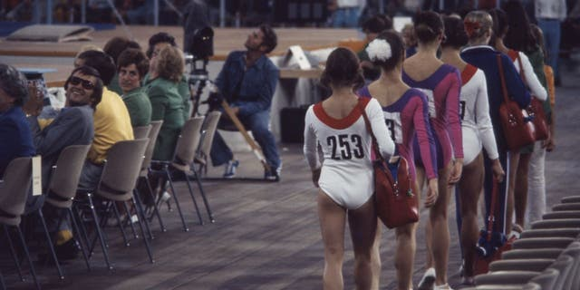 Athletes competing in the women's gymnastic event at the Munich 1972 Summer Olympics wore colorful leotards with long sleeves.