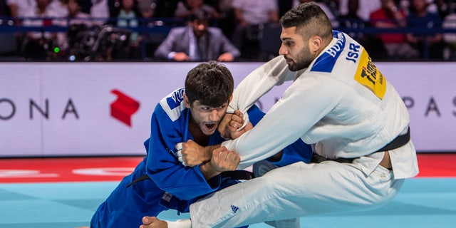 Behruzi Khojazoda of Tajikistan (blue judogi), 24, throws Tohar Butbul of Israel for an ippon during the 2019 Tokyo World Judo Championships at the Nippon Budokan on August 27, 2019 in Tokyo, Japan. (Photo by David Finch/Getty Images)