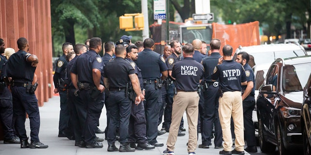 New York Police Department (NYPD) officers stand guard outside of Washington Square Park amid a rise of gun violence in New York, U.S., on Saturday, July 17, 2021. Photographer: Michael Nagle/Bloomberg via Getty Images