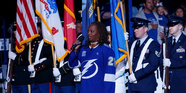 U.S. Air Force veteran Sonya Bryson-Kirksey is seen in 2018, singing the national anthem before an NHL playoff game between the Tampa Bay Lightning and the New Jersey Devils, in Tampa, Florida. (Getty Images)