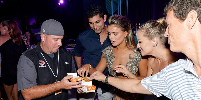 From left: Sami Siddiqui, Brooks Nader and Kristen Louelle Gaffney visit the Popeyes Nuggets activation at the Sports Illustrated Swimsuit Party on July 23, 2021 in Hollywood, Florida.