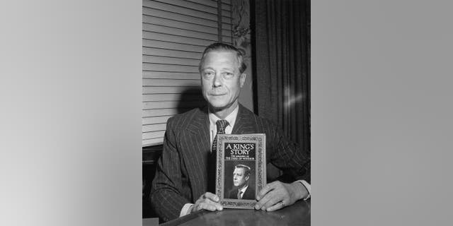 """The Duke of Windsor (1894-1972), former King Edward VIII, with his memoirs, entitled """"The Story of a King: The Memoirs of the Duke of Windsor,"""" around 1951."""