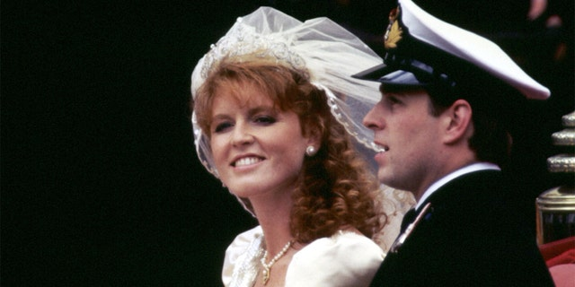 The Duke and Duchess of York (formerly Prince Andrew and Miss Sarah Ferguson) smile happily during their carriage procession after their wedding at Westminster Abbey in London, circa 1986.