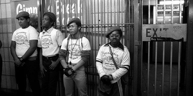 Portrait of four members of the Guardian Angels as they stand in a subway station, New York, New York in the mid-1980s.