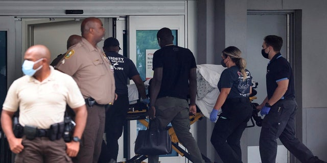 Martine Moise, first lady of Haiti, arrives at Jackson Health System's Ryder Trauma Center, in Miami, for treatment, Wednesday, July 7, 2021, after being shot multiple times at her home earlier in the day in Port-au-Prince, Haiti. (Miami Herald via AP)