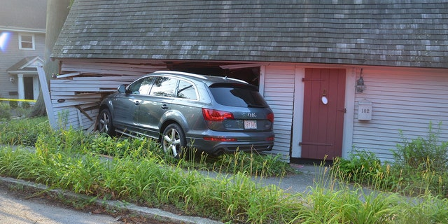 Half of the vehicle ended up inside the the Samuel Lincoln Cottage in Hingham, police said