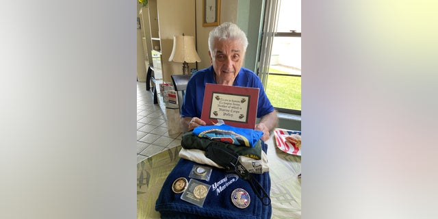 Peter V. Ruvolo with gifts presented to him from The Young Marines of the Palm Beaches.