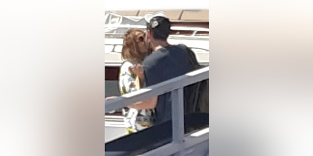 Hollywood couple Jennifer Lopez and Ben Affleck pack on the PDA as they embraced in a kiss on a dock in the port of Naples, Italy.