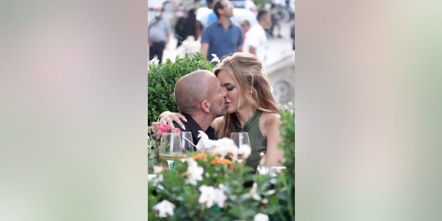'Selling Sunset' stars Chrishell Stause and Jason Oppenheim passionately kiss during a romantic vacation in Rome.