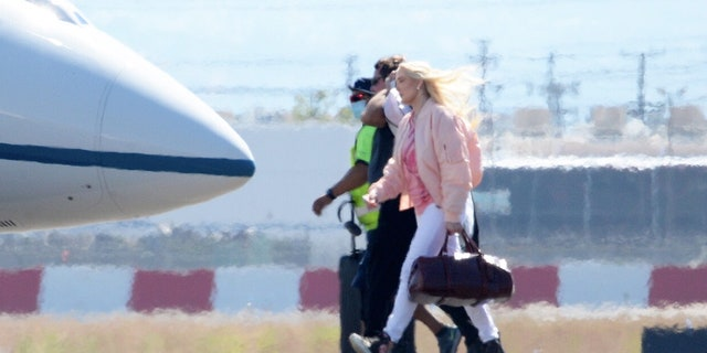 Erika Jayne was spotted boarding a private jet despite her mounting legal and financial troubles.