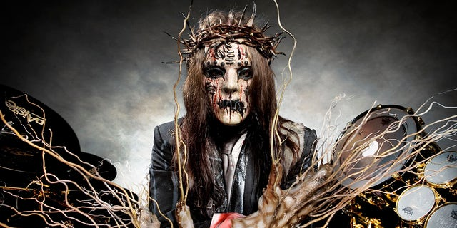 Joey Jordison in her Slipknot outfit.