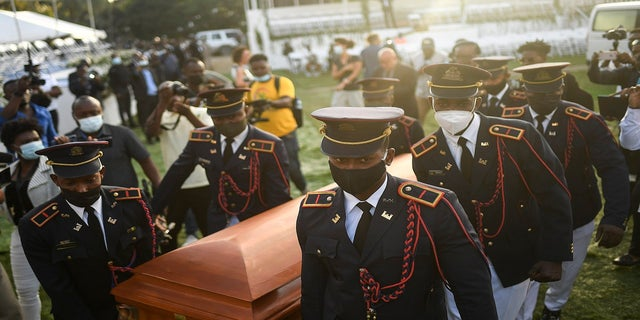 Police carry the coffin of slain Haitian President Jovenel Moise at the start of the funeral on Friday.