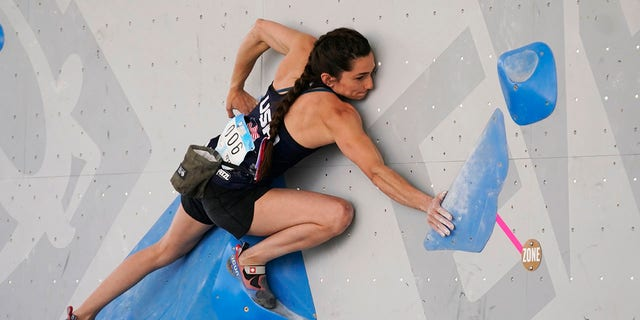 The United States' Kyra Condie climbs during women's boulder qualification at the climbing World Cup on May 21, 2021, in Salt Lake City, Utah. (AP Photo/Rick Bowmer, File)