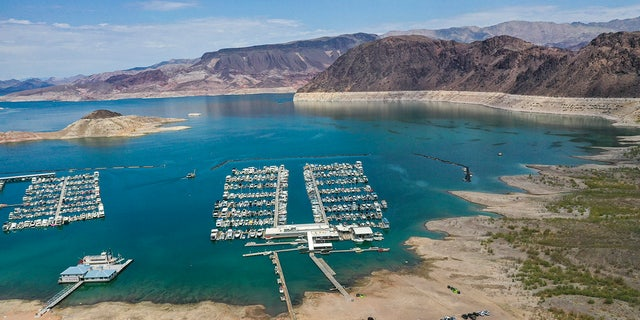 Lake Mead, NV - June 28: An aerial view of droughts effect at Hemenway Harbor, Lake Mead, which is at its lowest level in history since it was filled 85 years ago, Monday, June 28, 2021. The ongoing drought has made a severe impact on Lake Mead and a milestone in the Colorado River's crisis. High temperatures, increased contractual demands for water and diminishing supply are shrinking the flow into Lake Mead. Lake Mead is the largest reservoir in the U.S., stretching 112 miles long, a shoreline of 759 miles, a total capacity of 28,255,000 acre-feet, and a maximum depth of 532 feet. (Allen J. Schaben / Los Angeles Times via Getty Images)