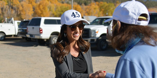 """COLLBRAN, CO - OCTOBER 22 : Lauren Boebert, Republican nominee for Colorado's 3rd congressional district, left, shakes hands with her supporter Patti Shear of Grand Junction during """"trash clean-up"""" event of West Slope Colorado Oil & Gas Association at Terrell Park in Collbran, Colorado on Thursday. October 22, 2020. (Photo by Hyoung Chang/MediaNews Group/The Denver Post via Getty Images)"""