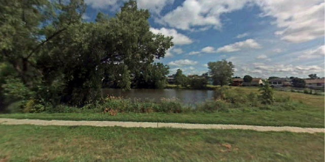 The pond in Lincoln, Neb., where the boy was spotted drowning.