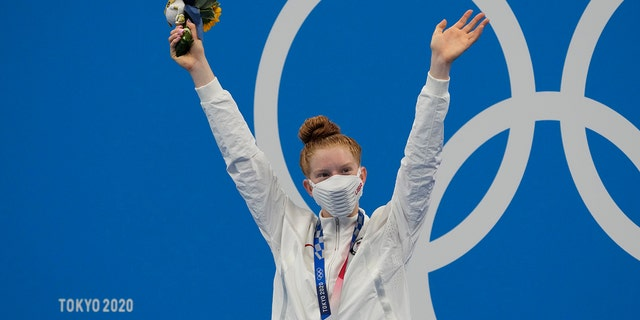 Lydia Jacoby of the United States poses with the gold medal after winning the final of the women's 100-meter breaststroke at the 2020 Summer Olympics, Tuesday, July 27, 2021, in Tokyo, Japan. (AP Photo/Petr David Josek)