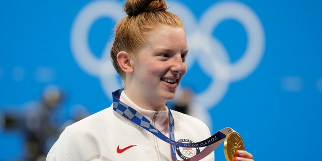 Lydia Jacoby of the United States poses with the gold medal after winning the final of the women's 100-meter breaststrokeat the 2020 Summer Olympics, Tuesday, July 27, 2021, in Tokyo, Japan. (AP Photo/Petr David Josek)